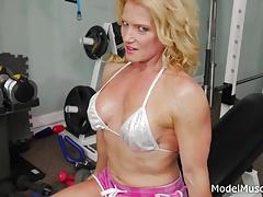 Muscle woman fingers herself