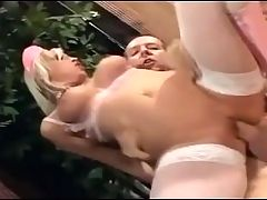 Blonde nurse fucking in boots and fishnet nylon