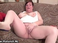 Old horny and busty housewife sticking fingers in her h