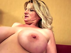 Chubby Granny Undresses And Show Tits