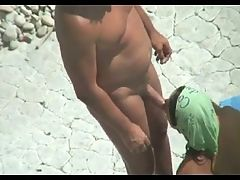 Peeping at nudist couple on the beach