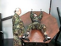 Restrained soldier girl gets her tits bared and nips tortured by master