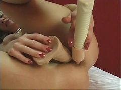 Horny hot and happy blonde shoves a dildo up her tight pussy