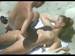 Peeping at a hot nudist couple on the beach