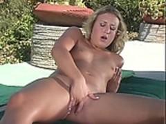 Mature blonde masturbates outsite