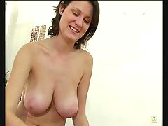 Girl with big tits gives a handjob