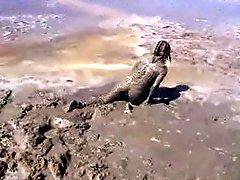 Marjorie ist getting wet and muddy in the ocean outdoor