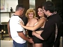 Two Matures in Stockings Enjoy a Gangbang
