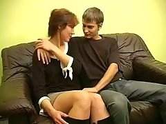 Mature woman and young man of couple