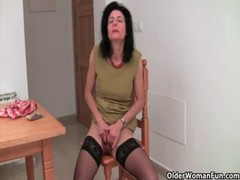 Grandma in lust is dildoing her full bushed pussy