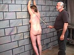 Saggy old bitch gets a good whipping of her fat thighs in dungeon