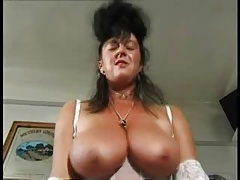 English lady with big tits offers her hairy vagina