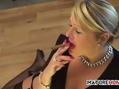 Mature blonde smoking a cigar