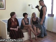 Older housewives are teasing horny beefy young guy in a