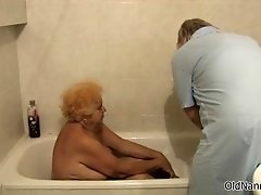 Nasty old woman gets her body rubbed during her shower